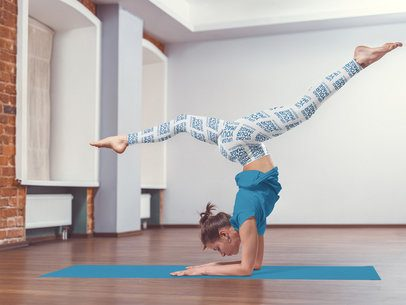 Mockup of a Woman Wearing Sublimated Leggings While Practicing Yoga 36303-r-el2