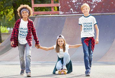 T-Shirt Mockup of Three Joyful Kids at a Skatepark 39329-r-el2