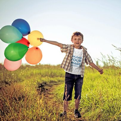 T-Shirt Mockup of a Boy Holding a Bunch of Balloons 39294-r-el2