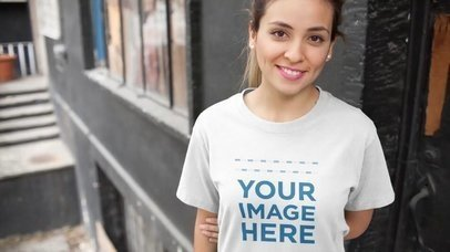 Smiling Girl Wearing a T-Shirt at a Building Facade Entrance Mockup Video a13048