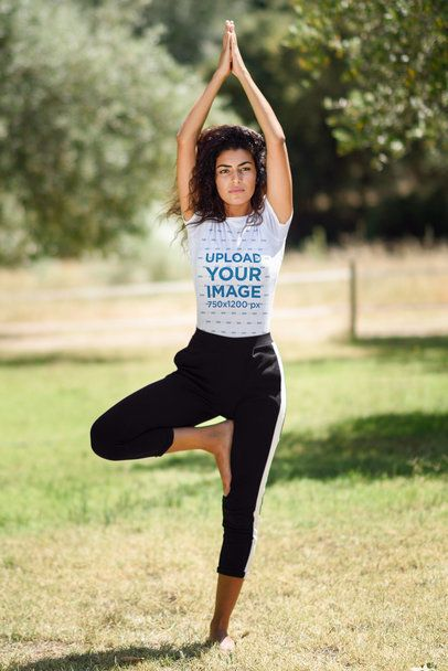 T-Shirt Mockup of a Woman Doing Yoga Outside on a Sunny Day 37626-r-el2