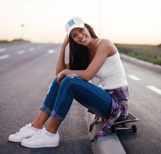 Dad Hat Mockup of a Female Skater Sitting on a Curb 37812-r-el2