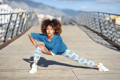 Sports Leggings Mockup of a Woman Stretching to Run 35287-r-el2