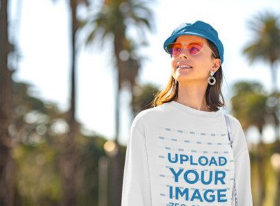 Crewneck Sweatshirt Mockup of a Young Woman with Sunglasses Posing on the Street 36279-r-el2