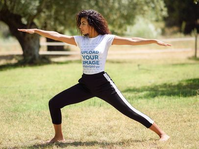 T-Shirt Mockup of a Woman Doing a Warrior Two Pose in Nature 37627-r-el2