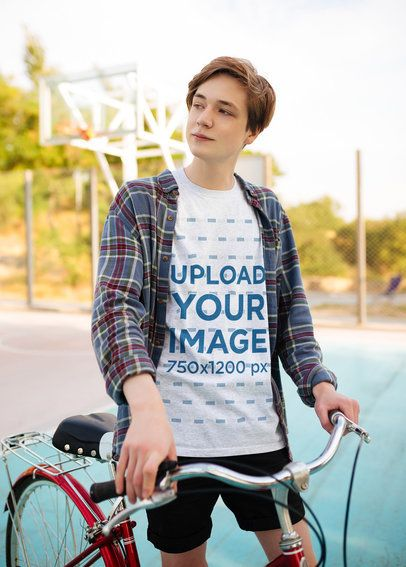 T-Shirt Mockup of a Man Posing with His Bike in a Suburban Setting 35035-r-el2