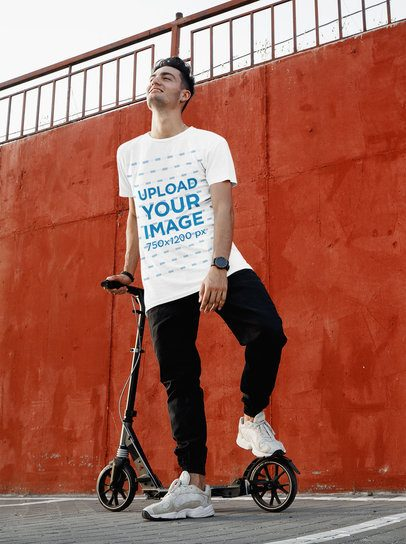 T-Shirt Mockup of a Man Posing with His Scooter 37584-r-el2