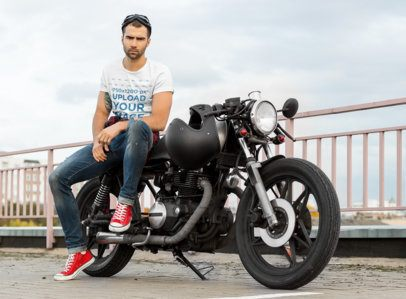 T-Shirt Mockup of a Trendy Man with a Tattoo Sitting on His Motorcycle 34493-r-el2