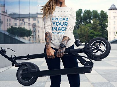 Long Sleeve Tee Mockup of a Woman Holding a Foldable Scooter 38126-r-el2