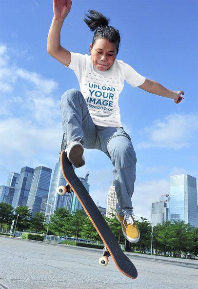 T-Shirt Mockup Featuring a Woman Doing a Skating Trick 37476-r-el2