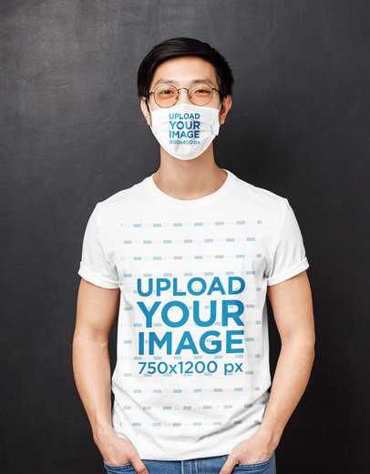 T-Shirt Mockup Featuring a Man With a Face Mask Standing Against a Dark Wall 39526-r-el2