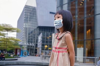 Mockup of a Little Girl Wearing a Face Mask and a Dress in the City 39419-r-el2