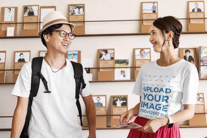 T-Shirt Mockup of a Traveler Couple at a Library 39456-r-el2