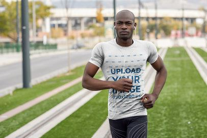 Mockup of a Man Jogging with a Round Neck T-Shirt 38091-r-el2