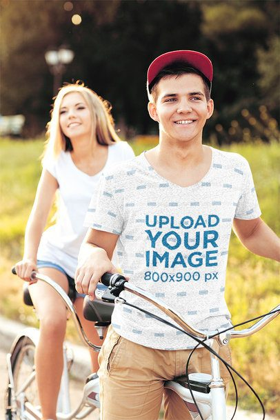 Sublimated T-Shirt Mockup of a Man Riding a Bicycle with his Girlfriend 36133-r-el2