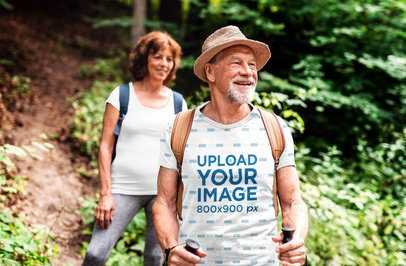 Mockup of a Senior Man with a Sublimated T-Shirt Hiking with a Friend 38169-r-el2