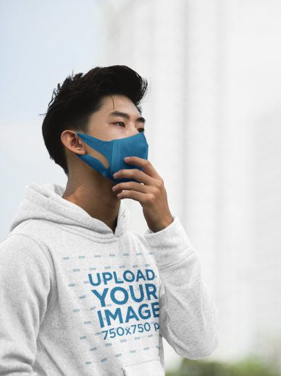Hoodie Mockup of a Young Man Wearing a Face Mask 35838-r-el2