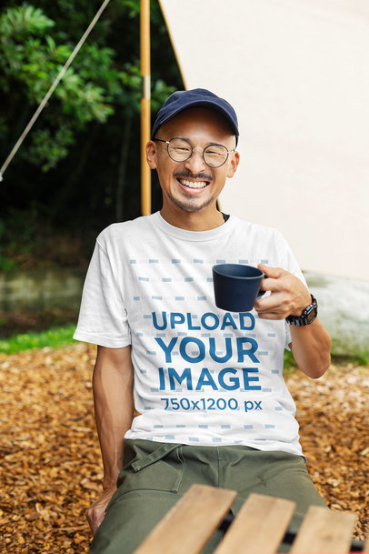 Mockup of a Happy Man Drinking Tea and Wearing a Customizable T-Shirt 39540-r-el2