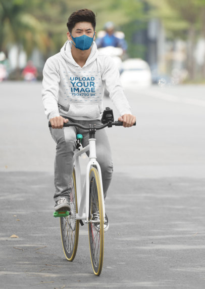 Pullover Hoodie Mockup Featuring a Man Riding a Bicycle 36257-r-el2