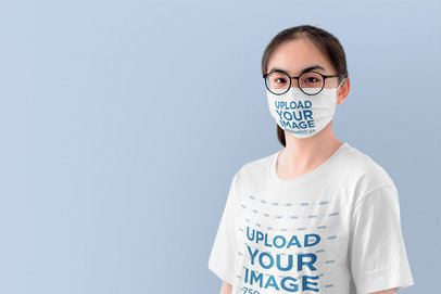 Face Mask Mockup of a Young Woman Wearing a Customizable T-Shirt at a Studio 39810-r-el2