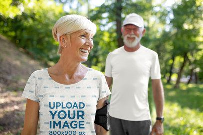 Mockup Featuring a Senior Woman Wearing a Sublimated Tee at the Mountains 39791-r-el2