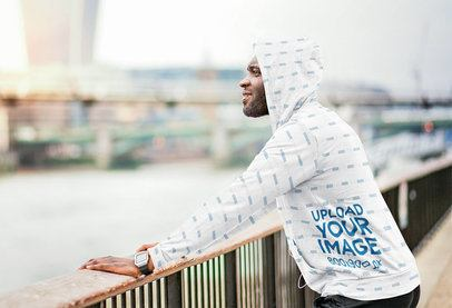 Mockup of a Man Wearing a Sublimated Hoodie while Looking at a River 37401-r-el2