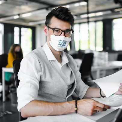 Face Mask Mockup of a Man Working in an Office 39866-r-el2