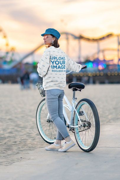 Mockup of a Young Woman with a Sublimated Sweatshirt at an Amusement Park 39843-r-el2