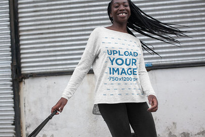 Mockup of a Happy Woman Wearing a Heather Bella Canvas Long Sleeve Tee 16209