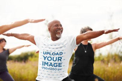 T-Shirt Mockup of a Senior Man Doing Yoga Outdoors 38942-r-el2