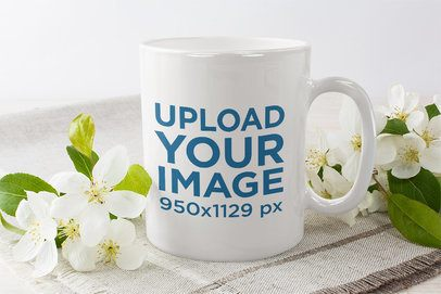 Mockup of an 11 oz Coffee Mug Surrounded by Delicate Flowers 36509-r-el2