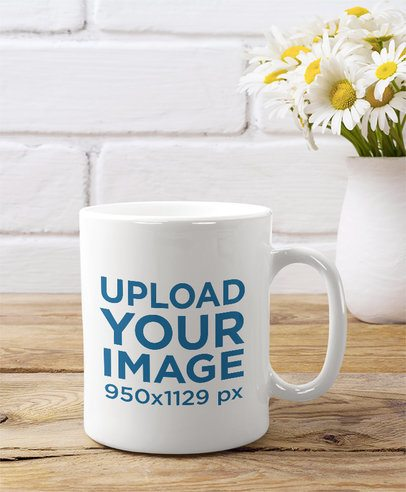 11 oz Coffee Mug Mockup Featuring a Small Vase Full of Daisy Flowers 36510-r-el2