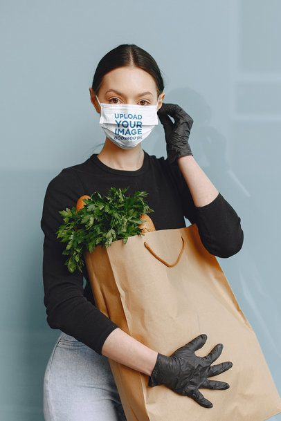 Face Mask Mockup of a Woman Carrying a Bag of Groceries 41030-r-el2