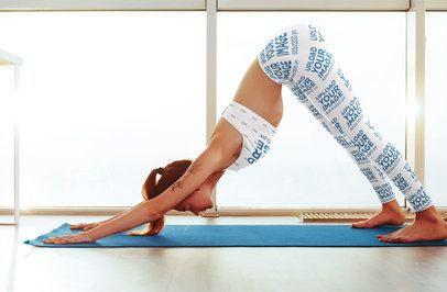 Mockup of a Woman with a Sports Bra and Sublimated Leggings Practicing Yoga 35273-r-el2