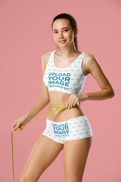 Sports Bra and Shorts Mockup of a Woman Measuring Her Waist 35608-r-el2