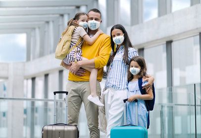 Mockup of a Family Wearing Face Masks at an Airport 39814-r-el2