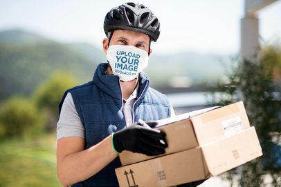 Mockup of a Delivery Guy Wearing a Sublimated Face Mask 40394-r-el2