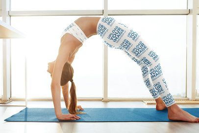 Sports Bra and Leggings Mockup of a Woman Doing a Bridge Yoga Pose in Her Home 35267-r-el2