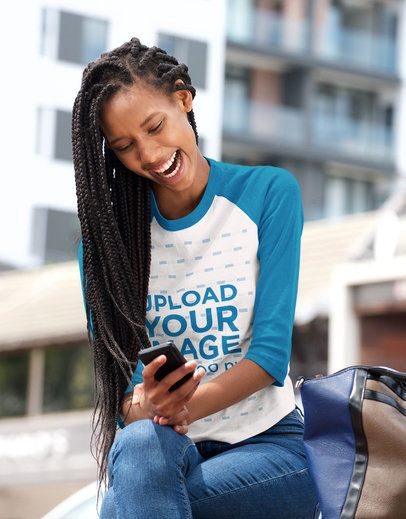 Raglan T-Shirt Mockup of a Woman Laughing While Looking at Her Phone 40212-r-el2