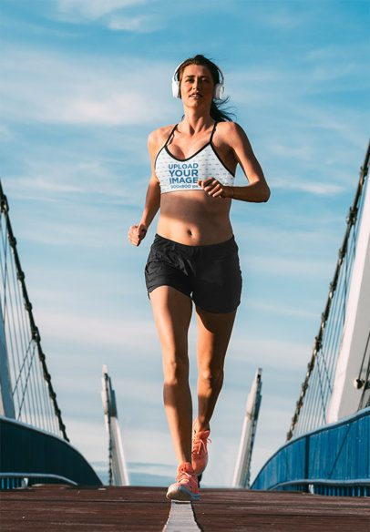 Sports Bra Mockup of a Woman Running with Headphones On 34957-r-el2