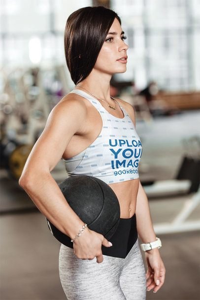 Sports Bra Mockup Featuring a Young Woman Carrying a Ball 35335-r-el2