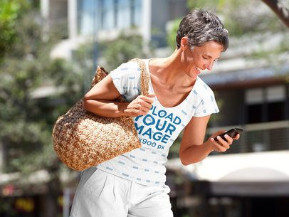 Mockup of a Short-Haired Woman with a Sublimated V-Neck Tee Checking Her Phone 39700-r-el2