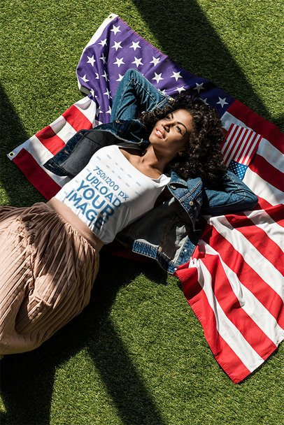 Tee Mockup of a Woman Lying on the Grass with a Flag 39950-r-el2