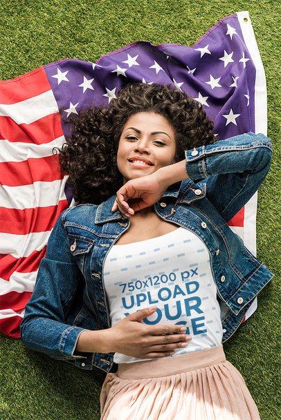 T-Shirt Mockup of a Smiling Woman Lying over a Flag 39951-r-el2