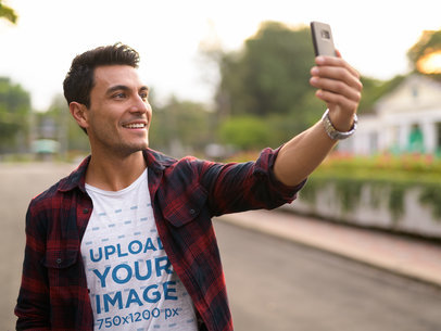 Selfie Mockup Featuring a Man Wearing a Basic T-Shirt on the Street 40448-r-el2