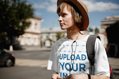 Mockup of a Woman with a Loose Tee Walking in a Foreign City 39694-r-el2