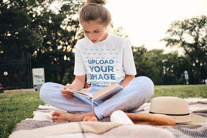 T-Shirt Mockup of a Woman on a Picnic Reading a Book 37801-r-el2