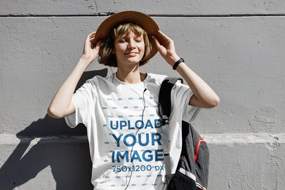Mockup of a Happy Woman with a Unisex T-Shirt Leaning on a Wall 39695-r-el2