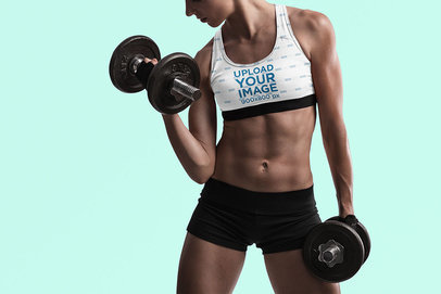 Studio Mockup of a Woman Wearing a Sports Bra and Training with Dumbbells 35574-r-el2