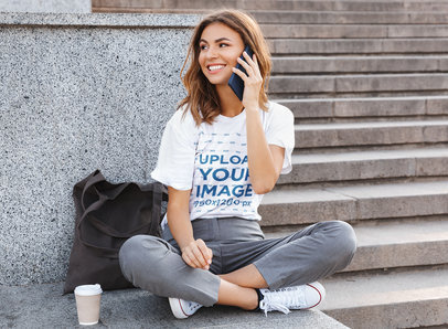 T-Shirt Mockup of a Woman Sitting on the Floor and Talking on the Phone 39775-r-el2